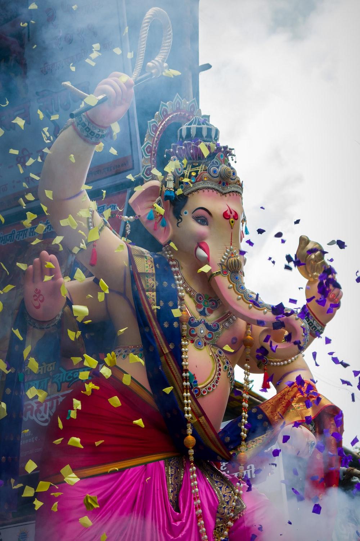 hindu deity statue under blue sky during daytime