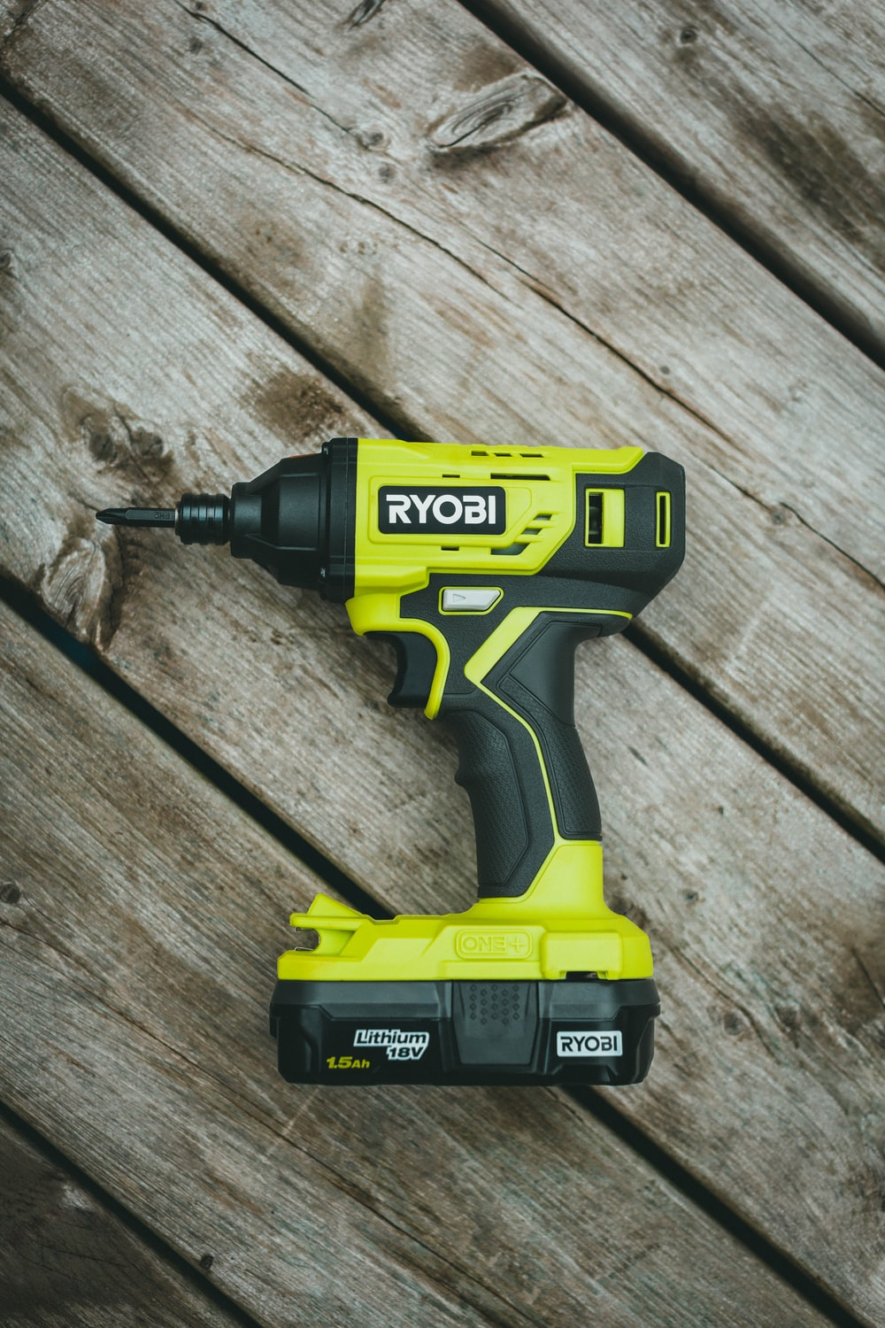green and black cordless hand drill