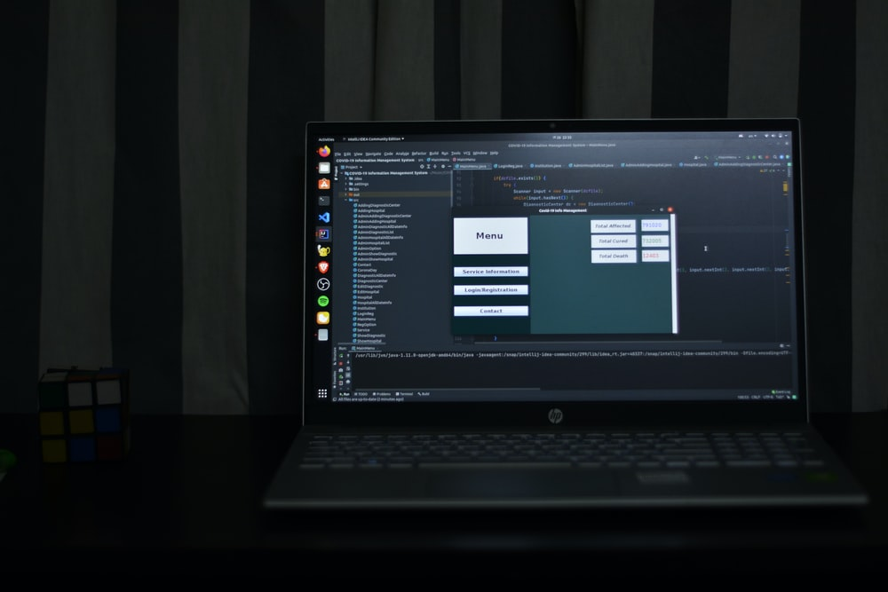 black hp laptop computer turned on displaying desktop