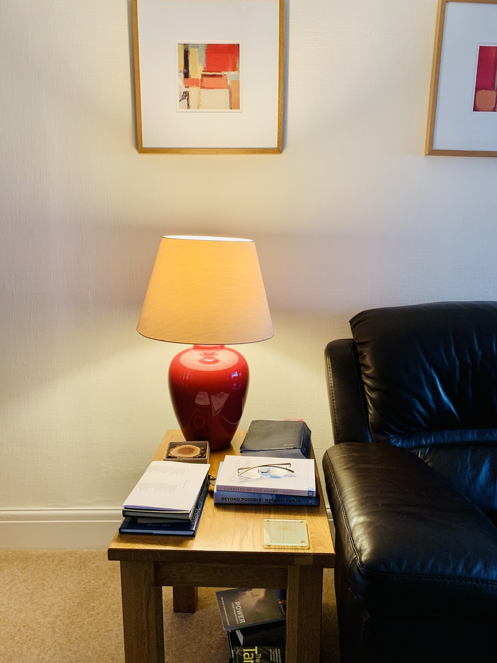 red and white table lamp on brown wooden table