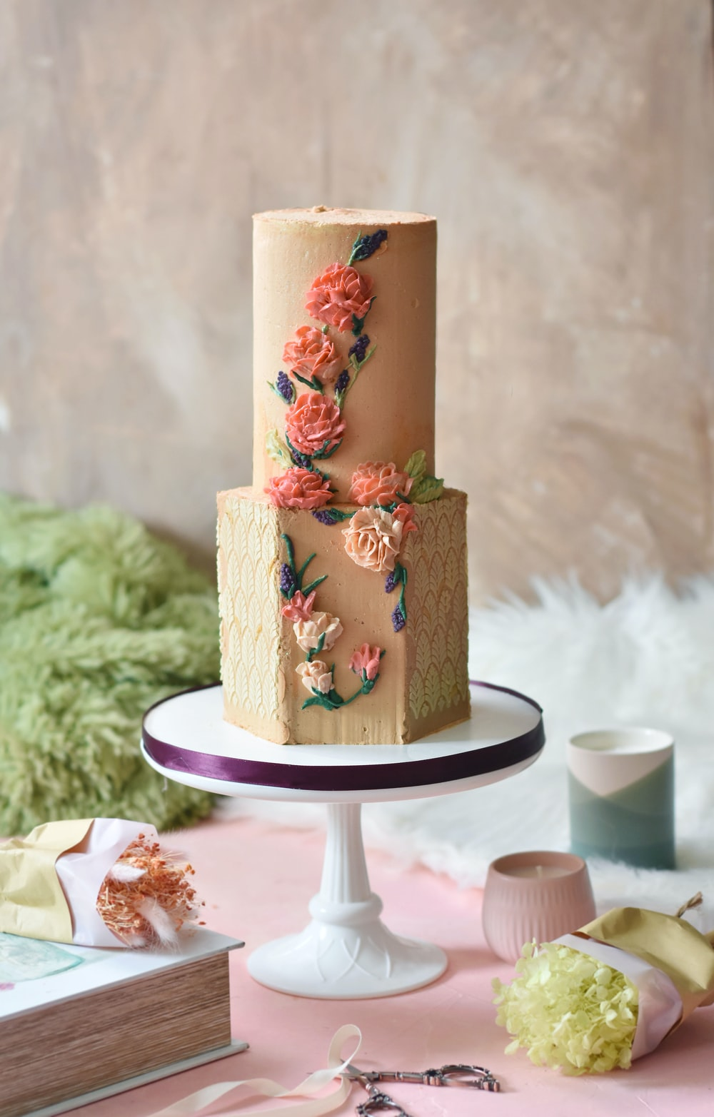 brown and red floral cake on white ceramic plate