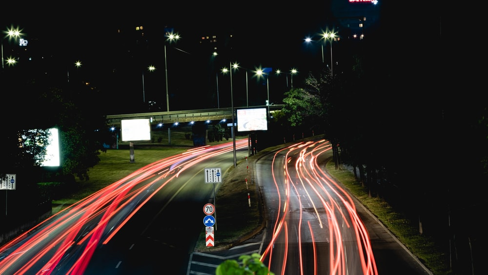 time lapse photography of cars on road during nighttime