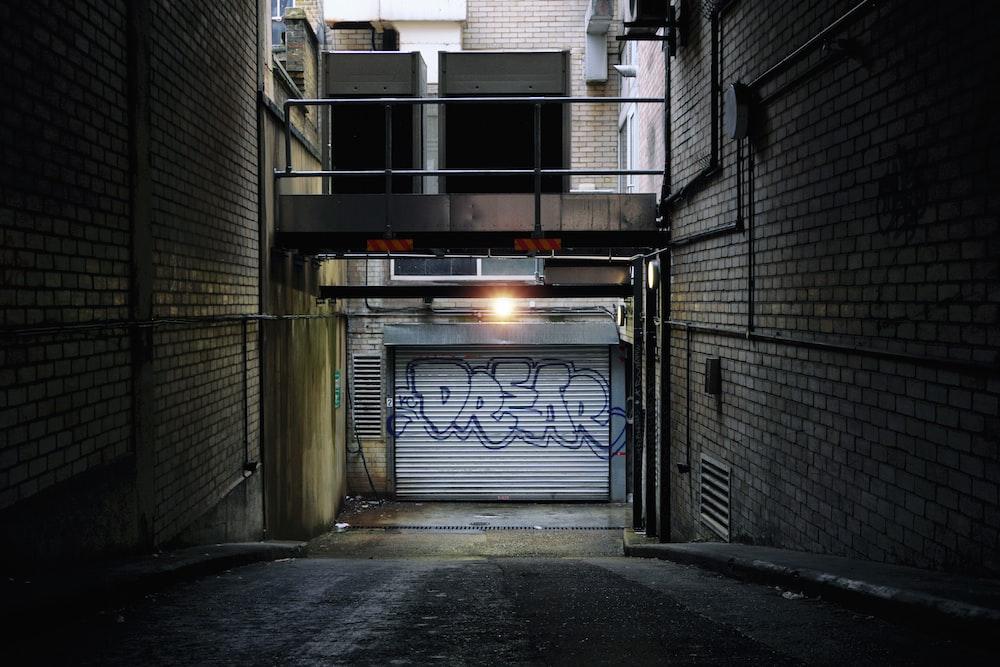 black metal gate near gray concrete building during daytime