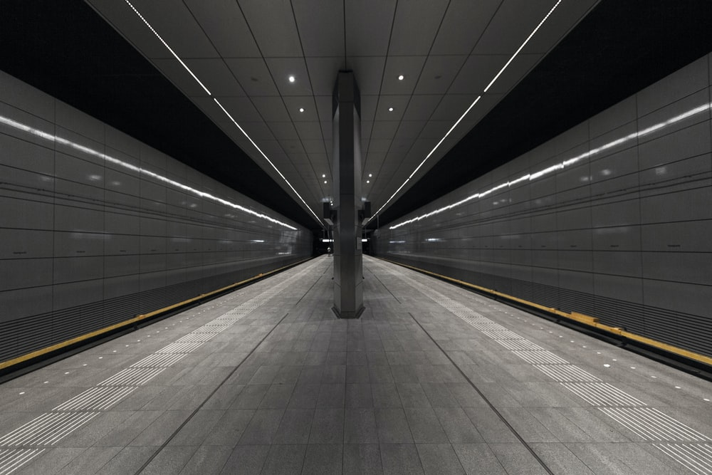 gray and white tunnel with white light