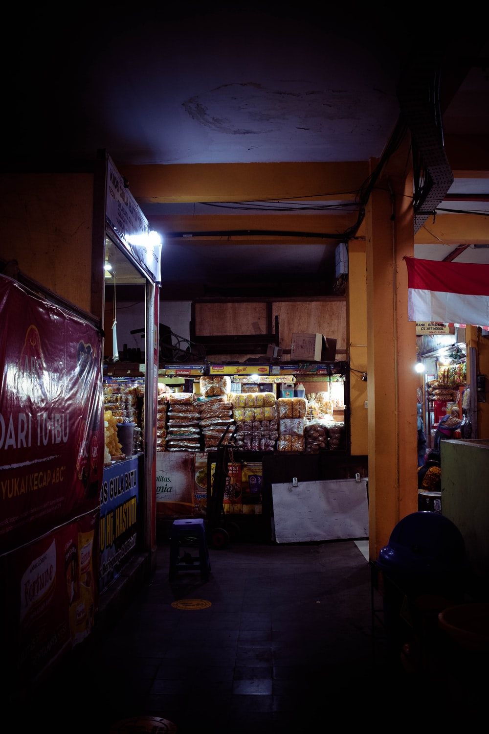 store with lights turned on during night time