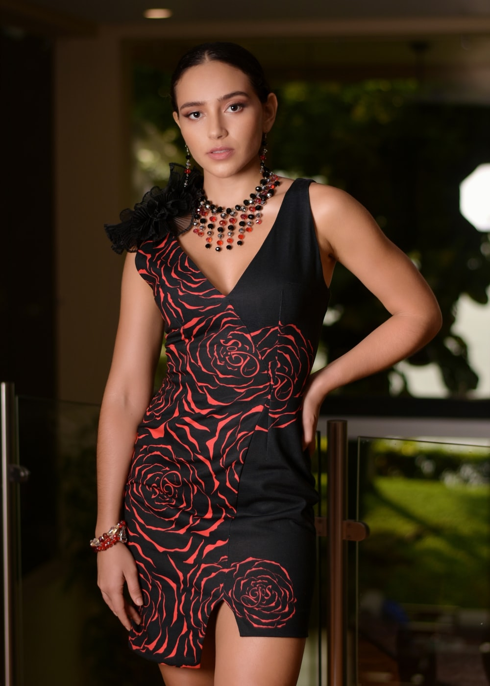 woman in black and red floral sleeveless dress