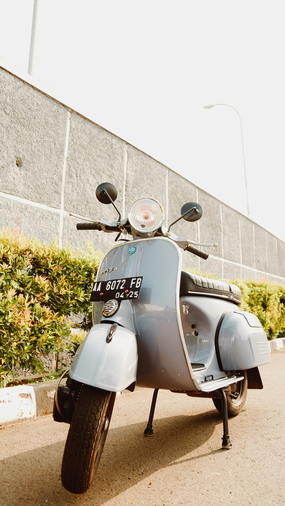 blue and gray motor scooter