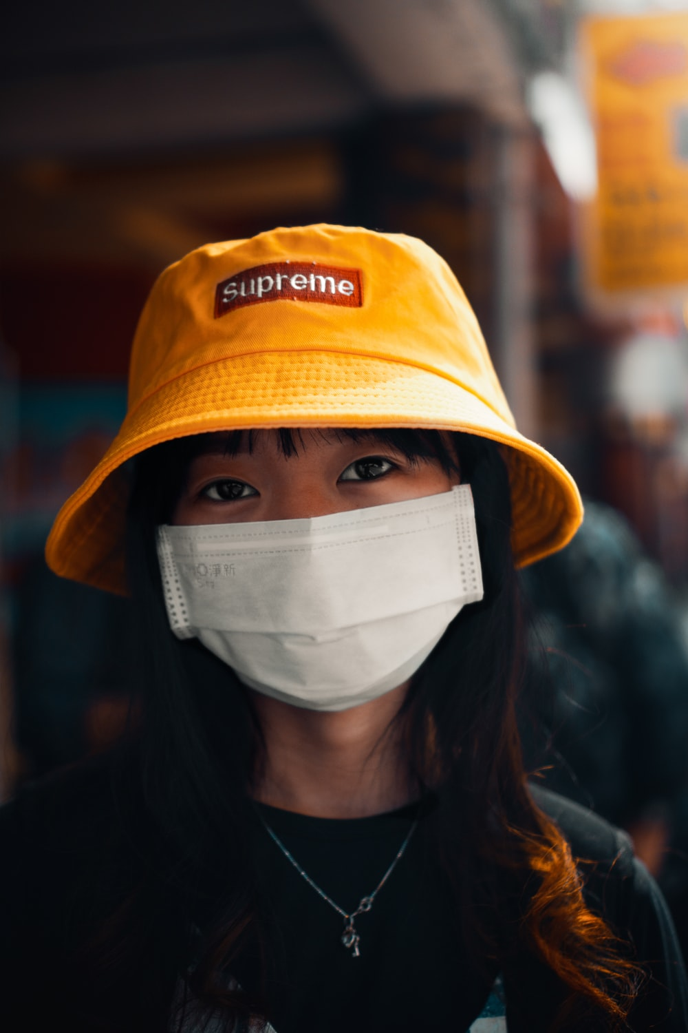 woman in orange and white fitted cap