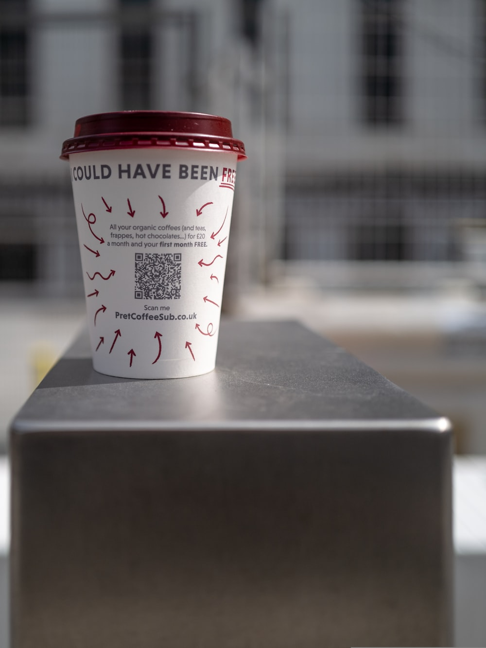 white and red plastic cup