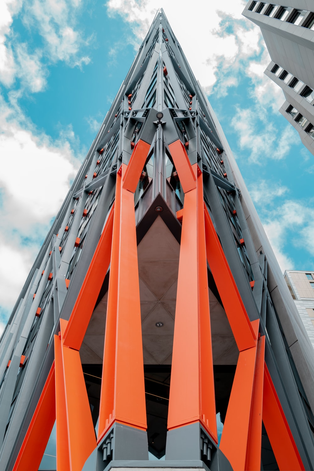 orange and gray concrete building under blue sky during daytime