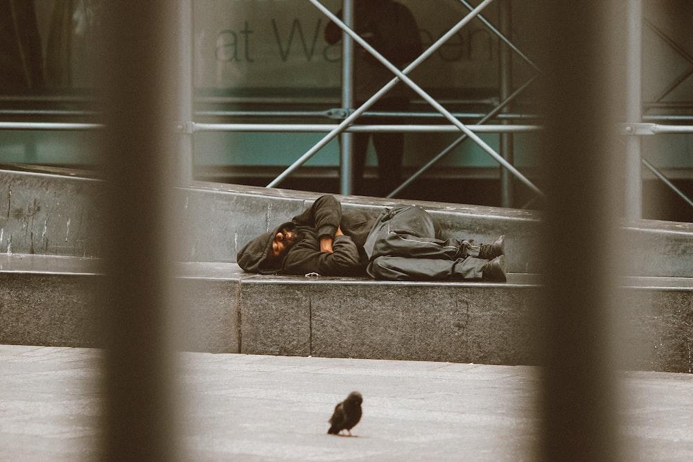 woman lying on floor near window