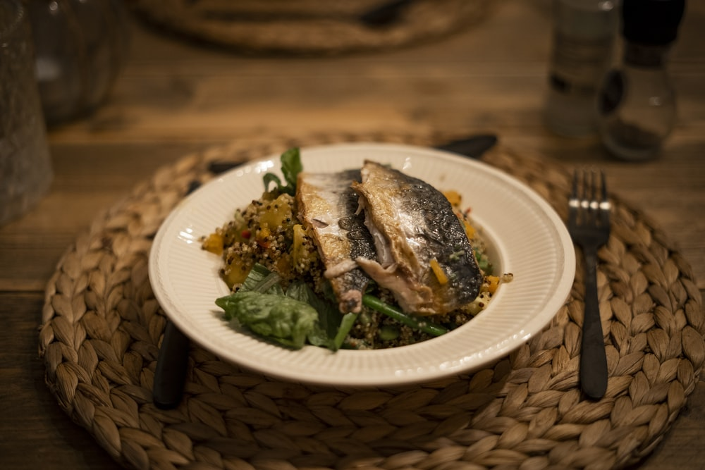 cooked fish on white ceramic plate