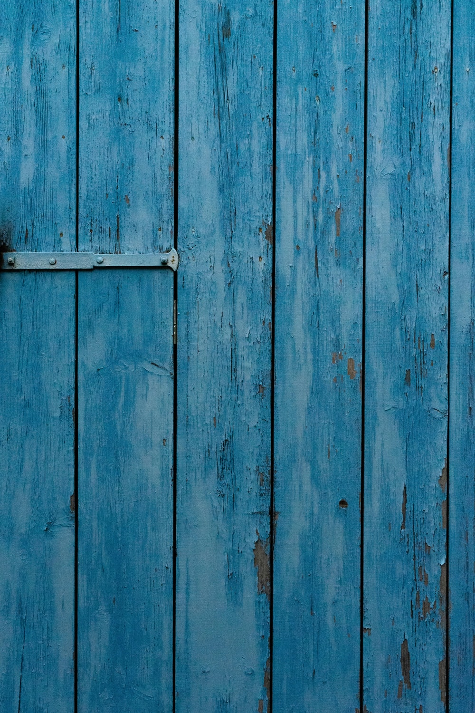 blue wooden door with white metal door handle