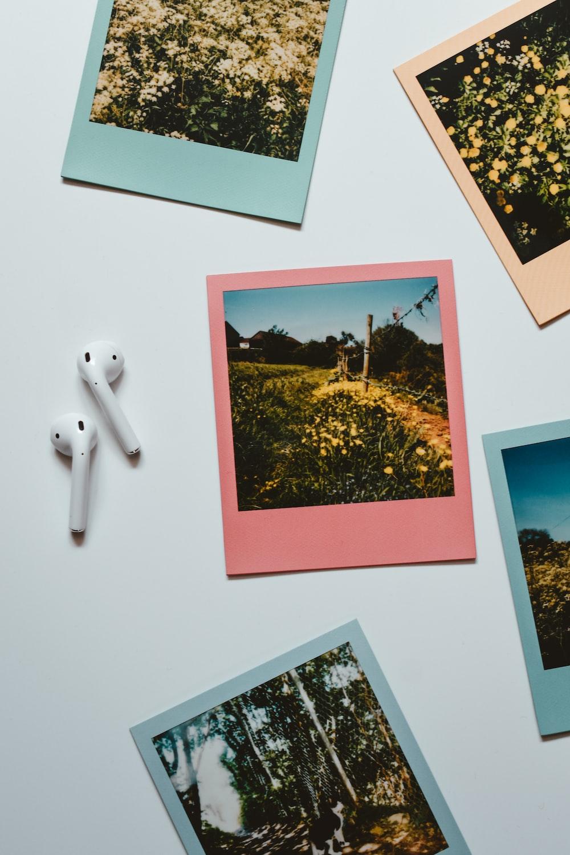 white apple earpods on white printer paper