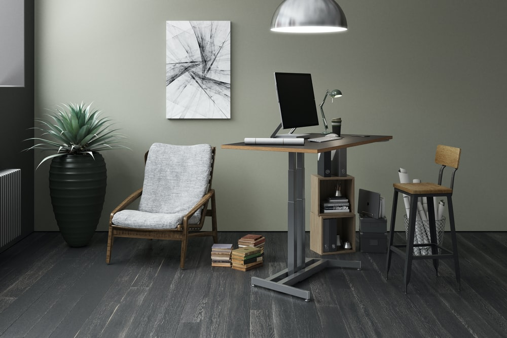 silver laptop computer on brown wooden table