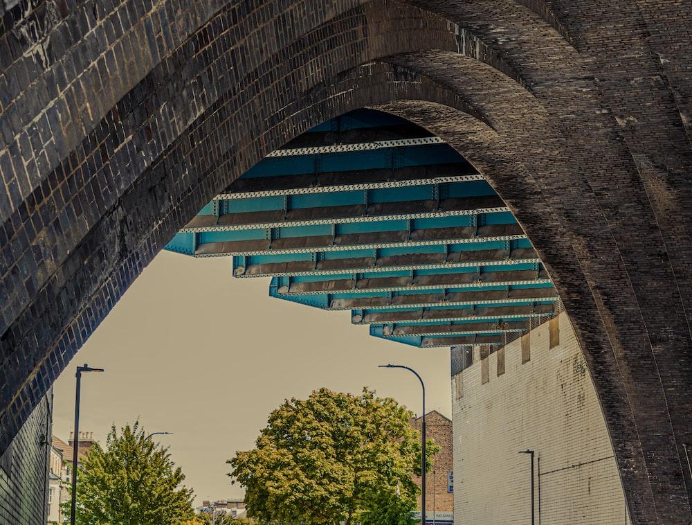 blue and white concrete arch bridge