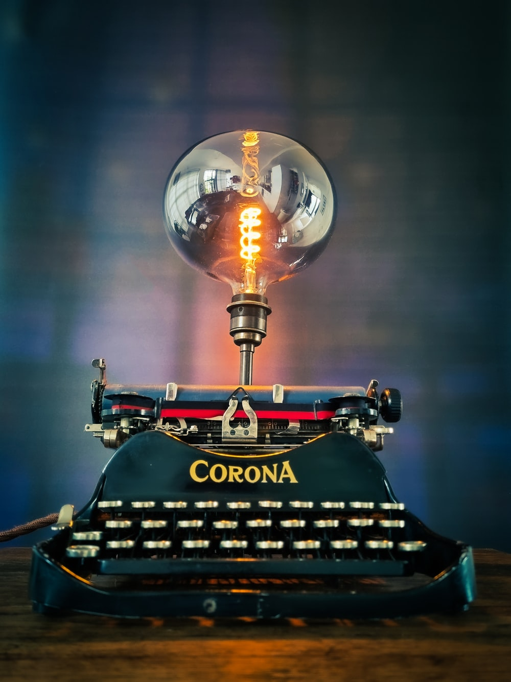 black and red typewriter on table