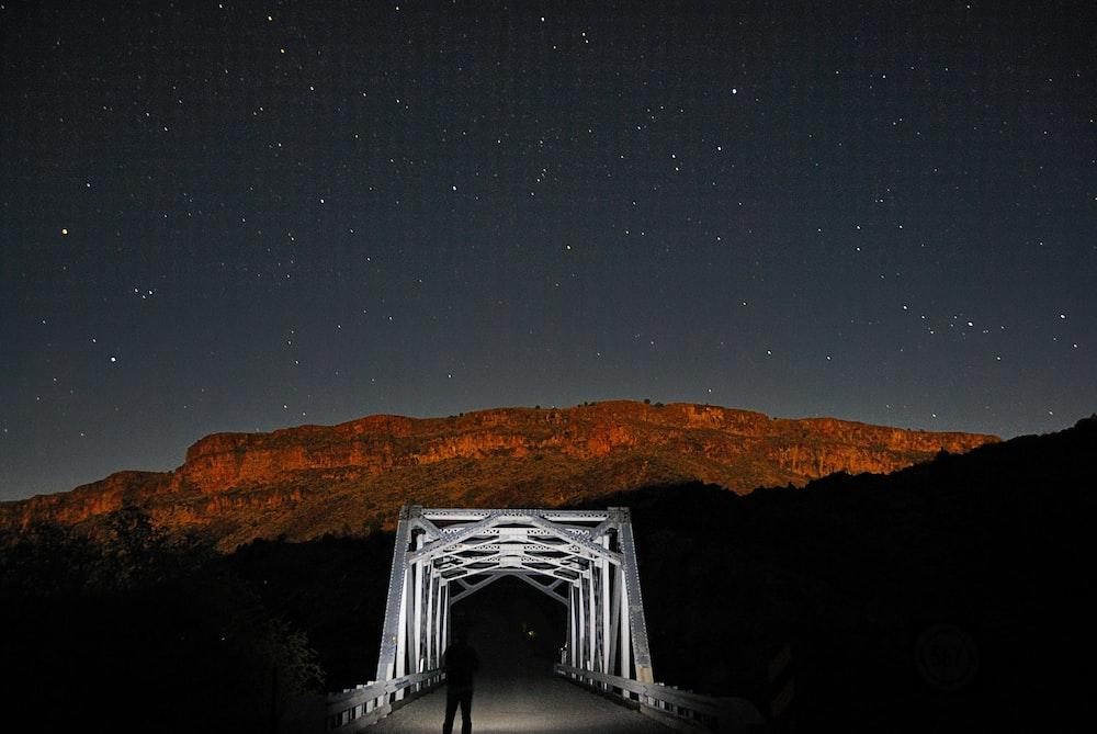 white bridge under starry night