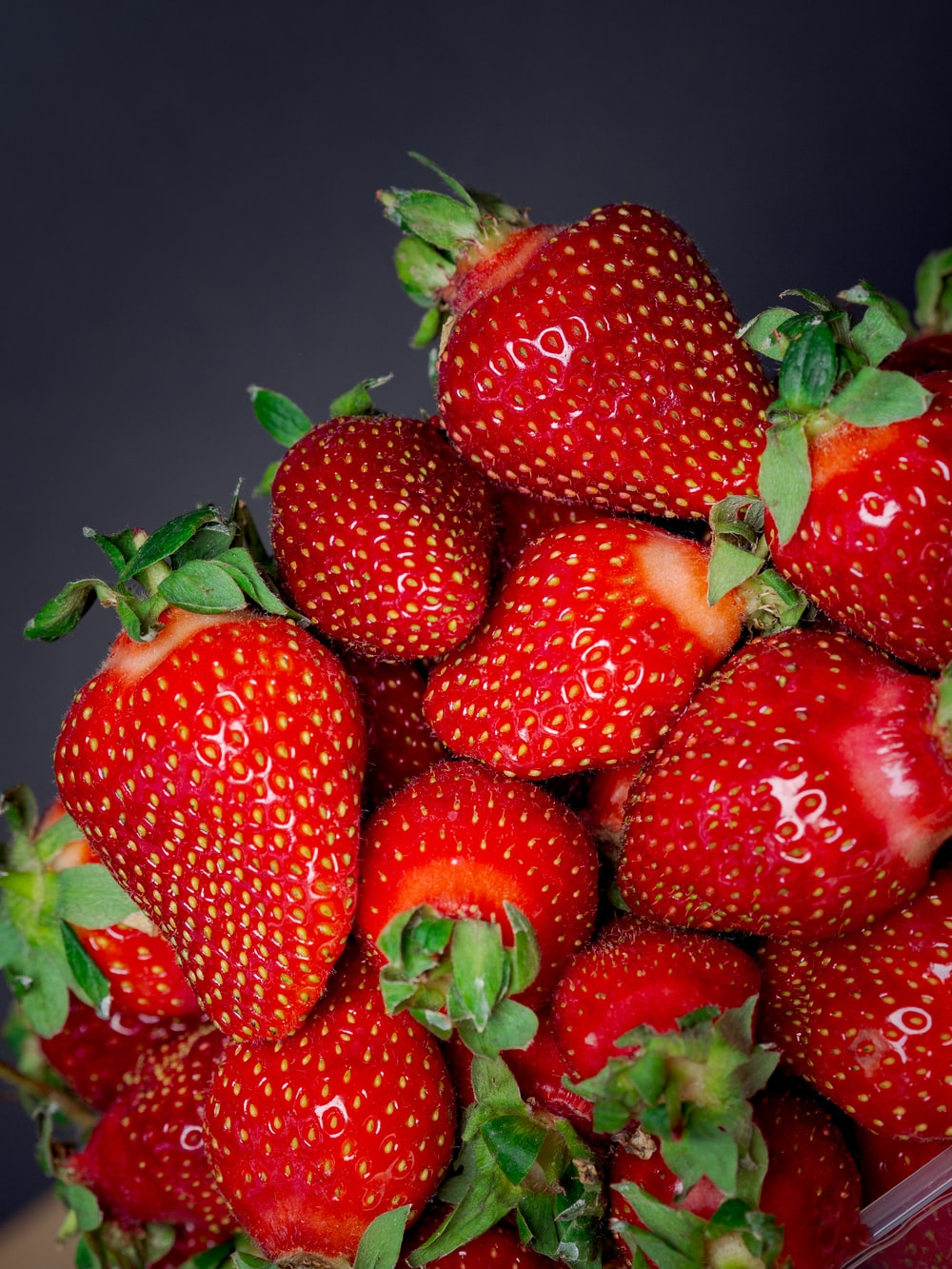 red strawberries in blue container