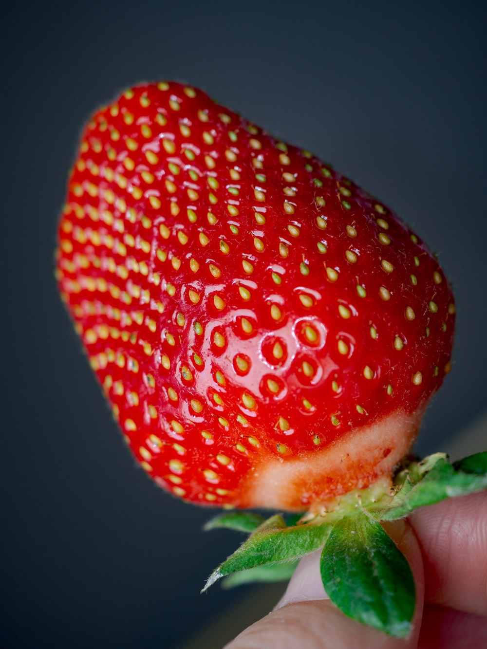 red strawberry in close up photography