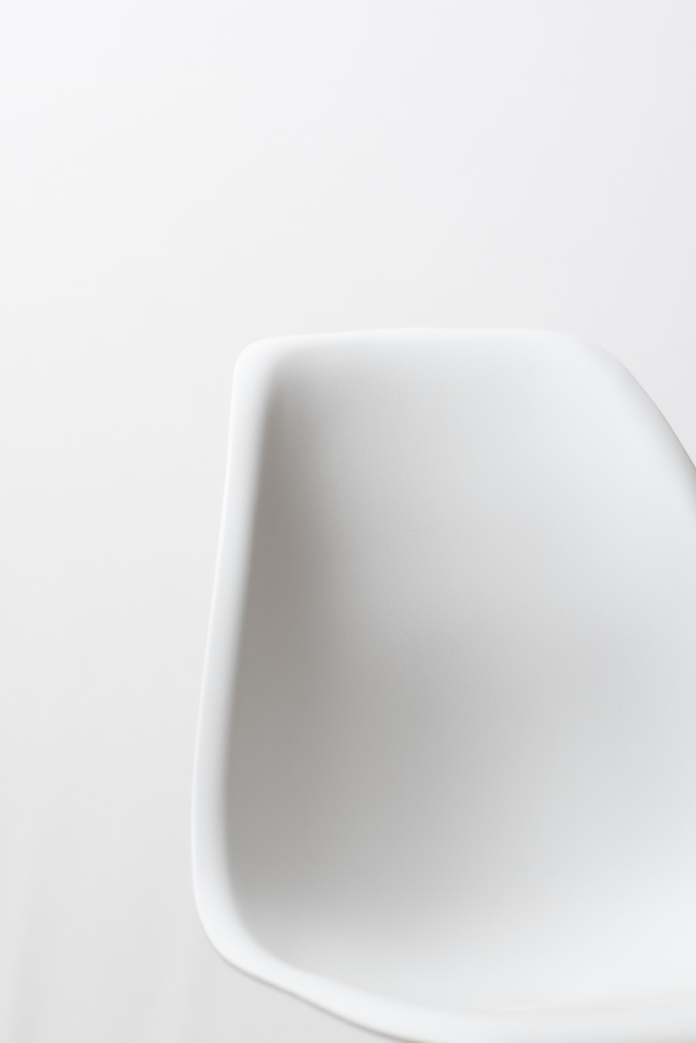 white plastic container on white surface