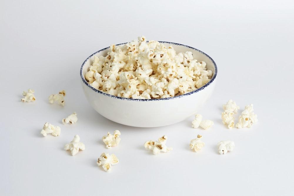 white popcorn in white ceramic bowl