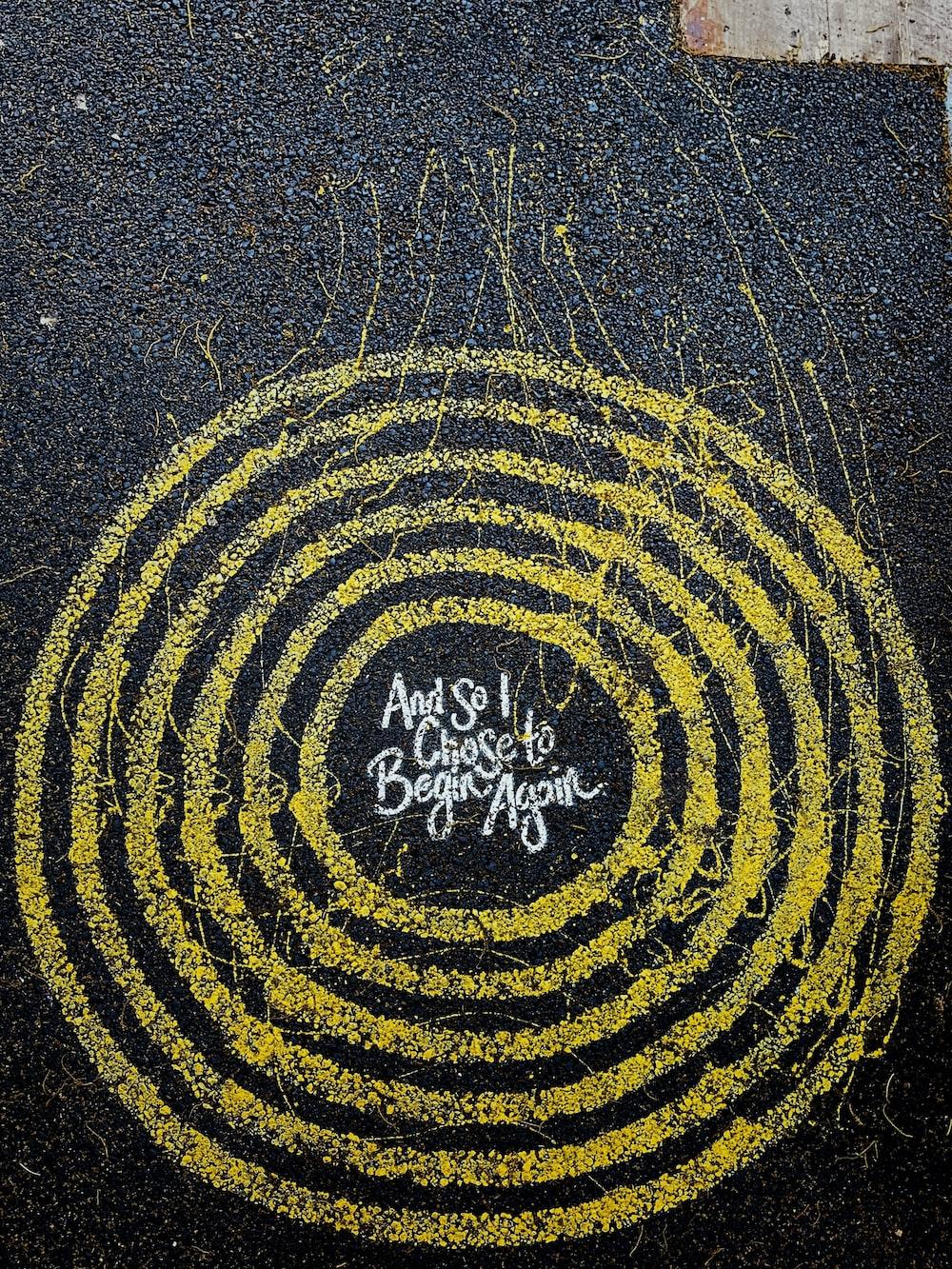 yellow and black round logo