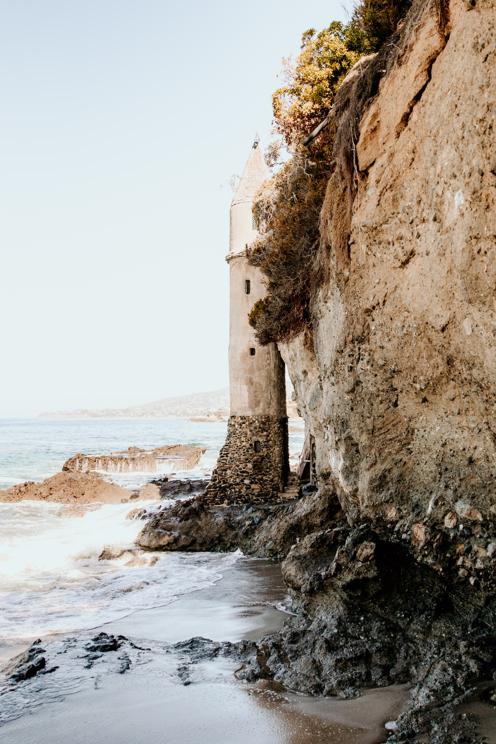 brown rock formation on sea shore during daytime