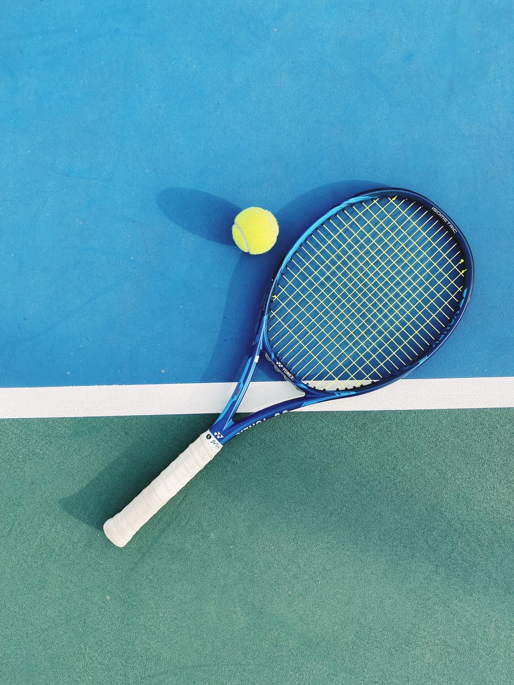 white and blue tennis racket