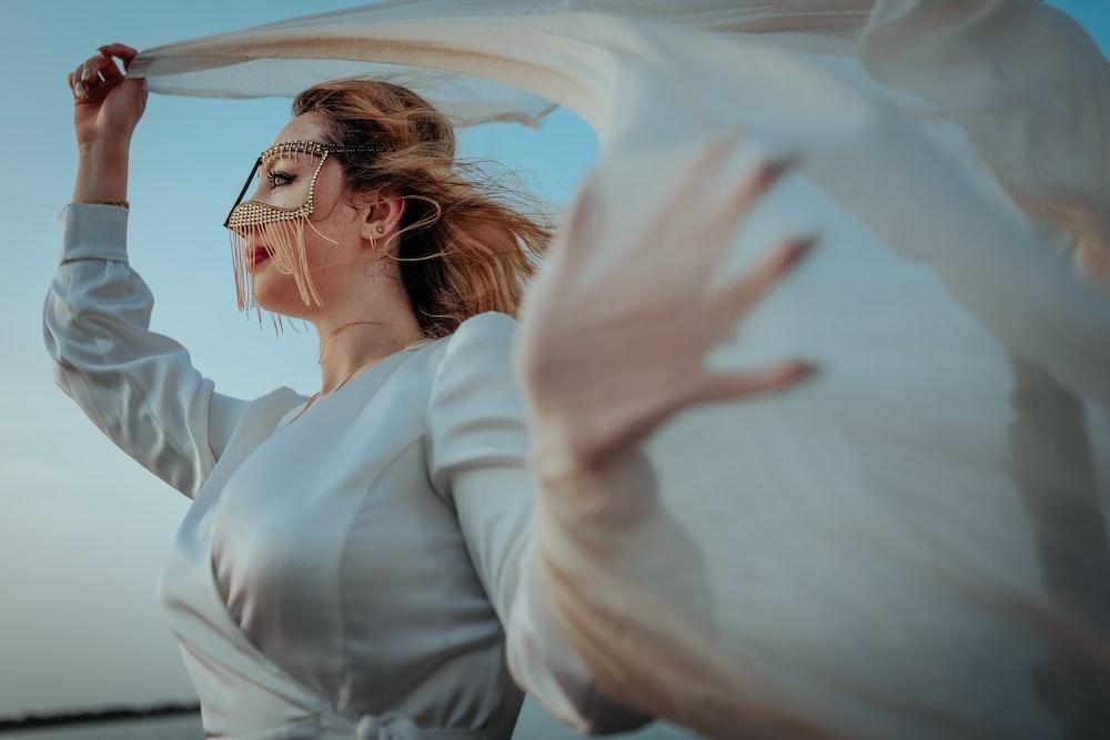 woman in white dress shirt wearing eyeglasses