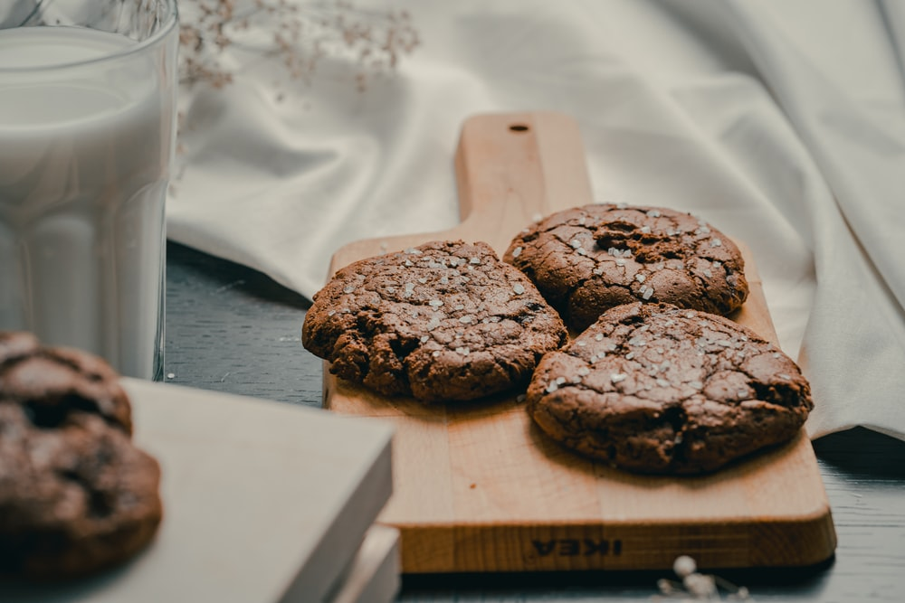 chocolate cookies on brown wooden chopping board
