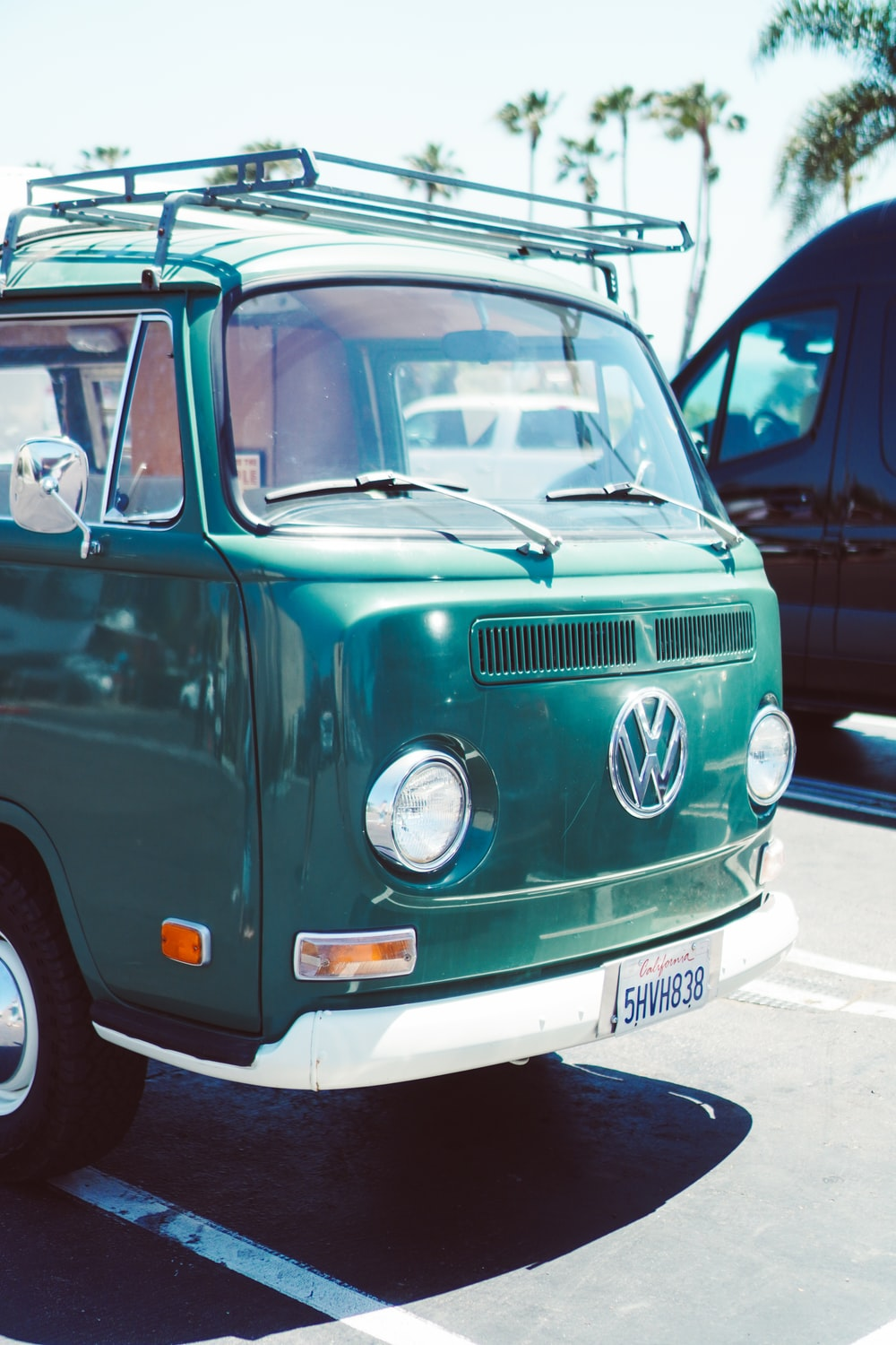 green and white volkswagen t-2