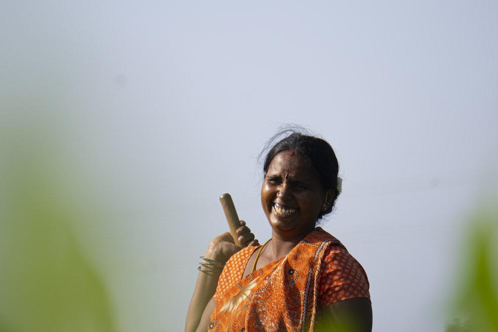 woman in orange and green sari