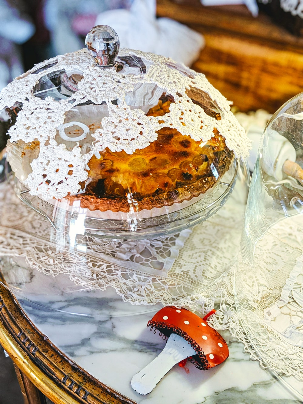 clear glass bowl with white and brown cake