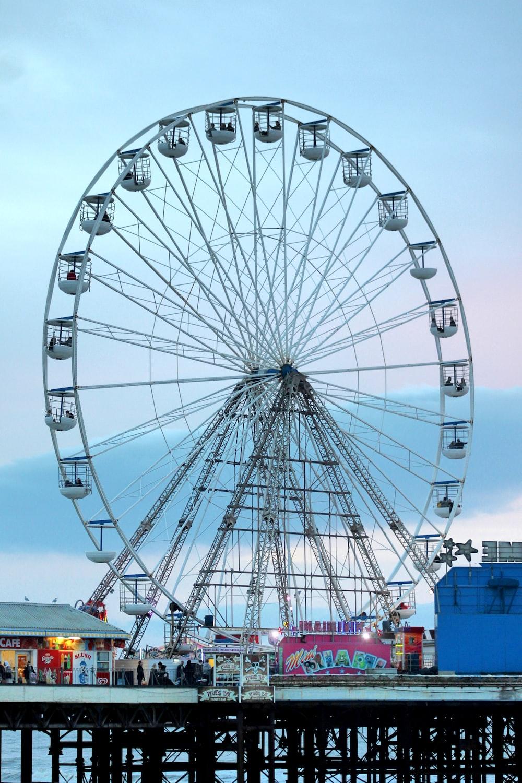 ferris wheel near body of water during daytime