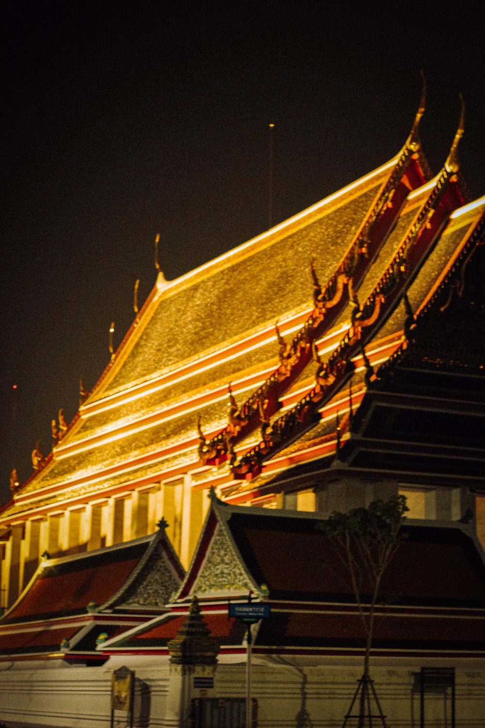 gold and black temple during night time