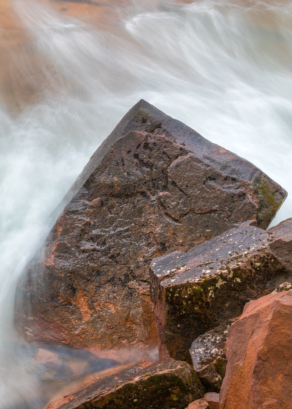 brown rock formation on water falls