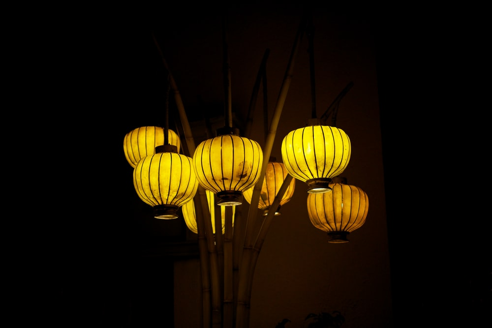 yellow paper lanterns turned on during nighttime