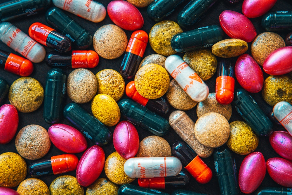 red and brown medication pill