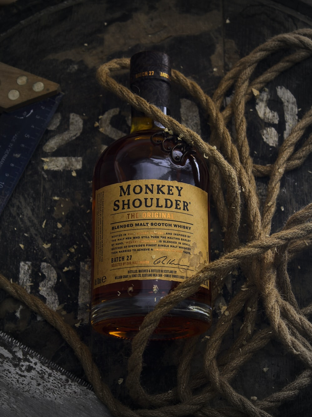 brown glass bottle on brown rope