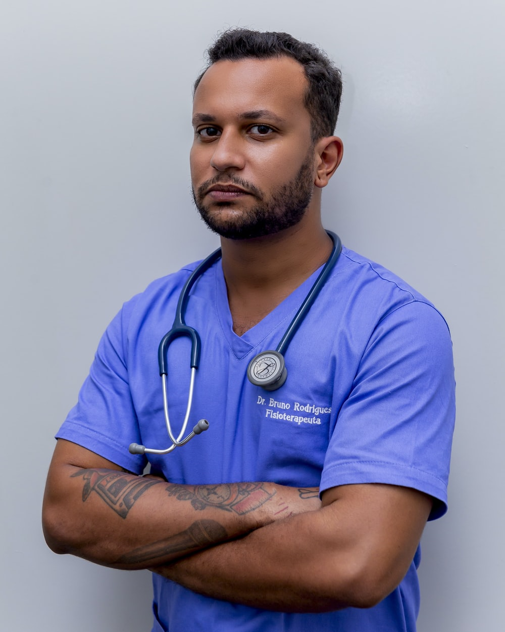 man in blue crew neck t-shirt wearing blue stethoscope
