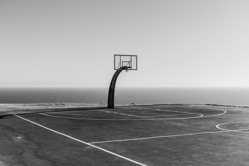 basketball hoop in grayscale photography