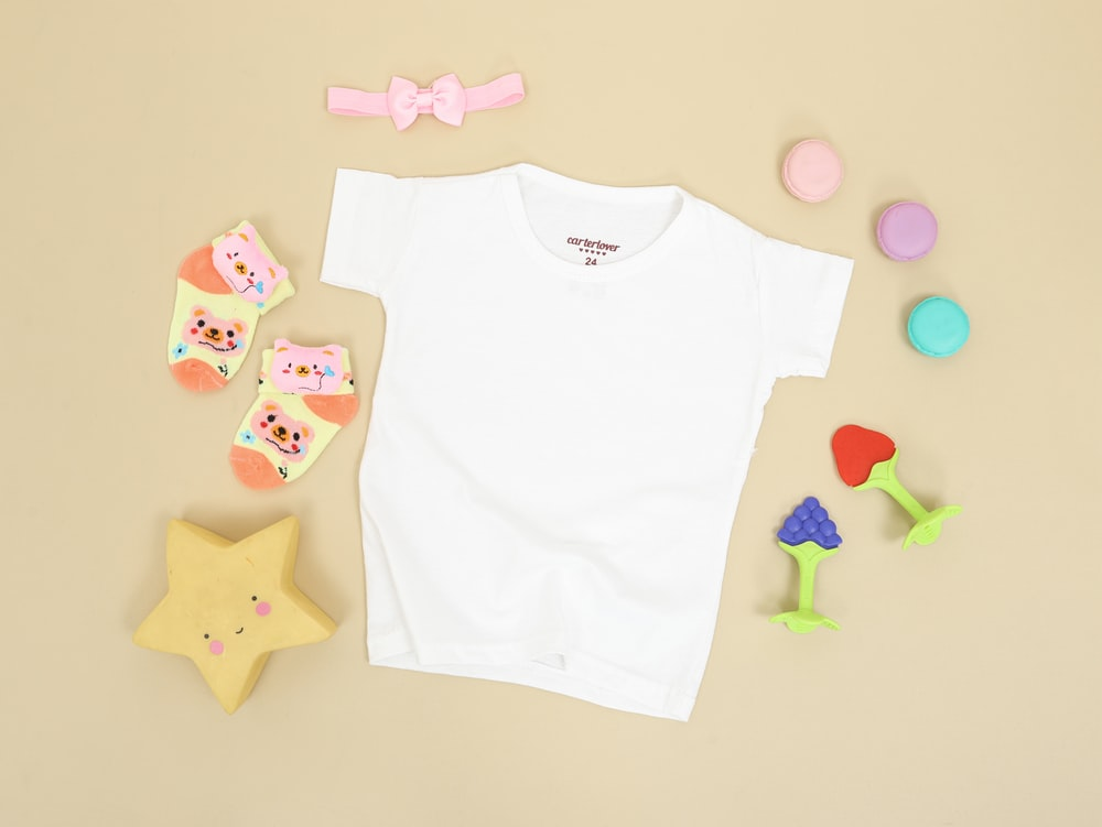 babys white onesie and pink and white bear print onesie