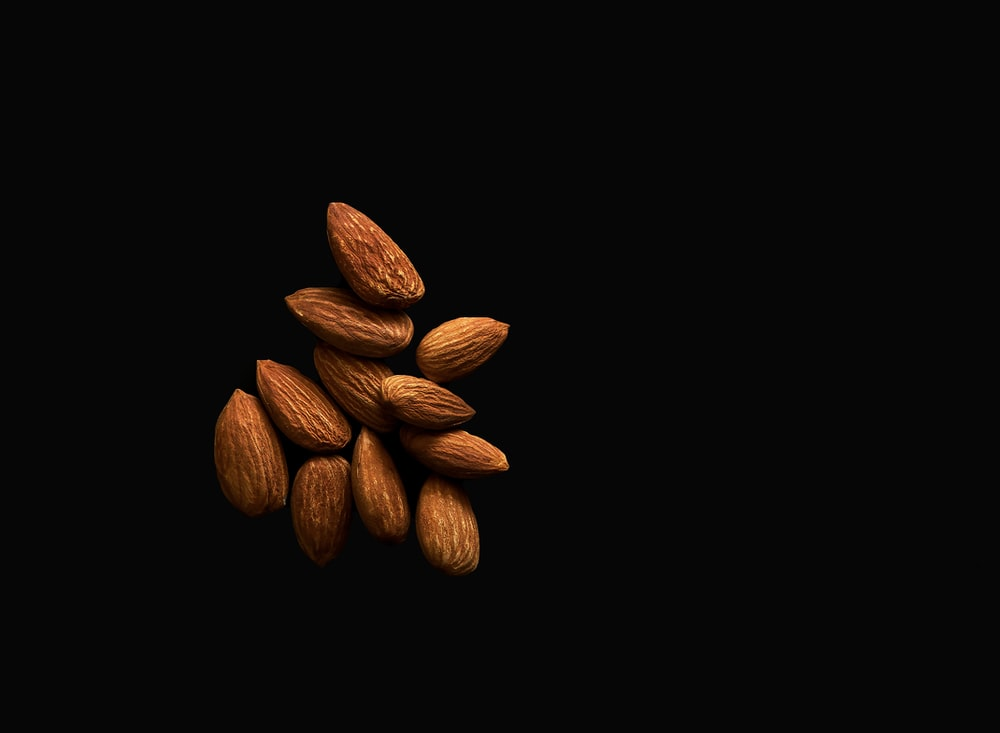 brown coffee beans on black background