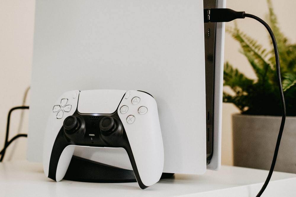 white and black xbox one game controller