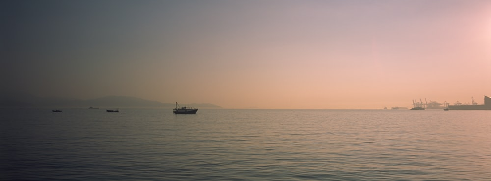 black boat on sea during daytime