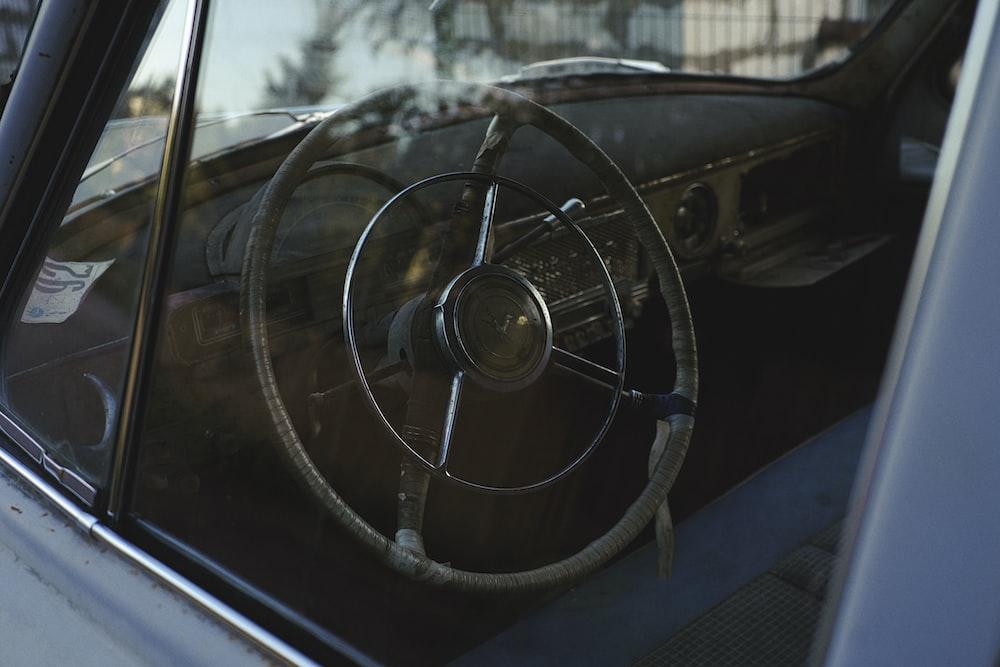 black car steering wheel during daytime