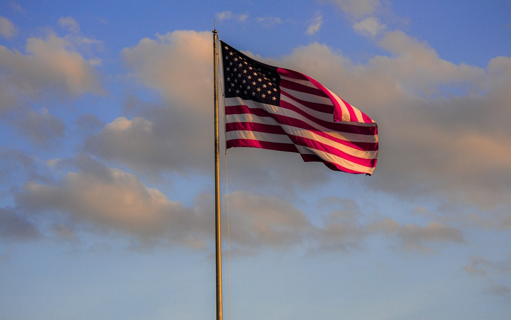 us a flag under cloudy sky during daytime