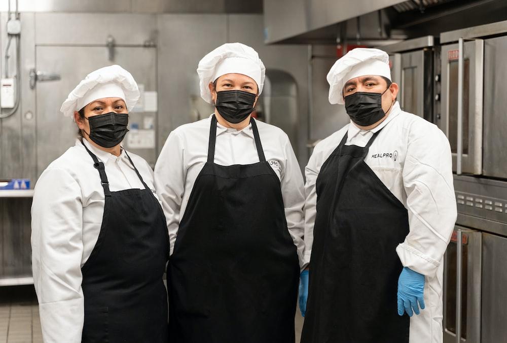 2 men in white chef uniform standing