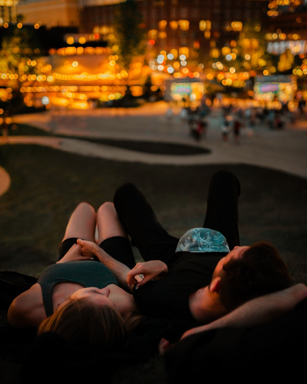 person lying on the ground during night time